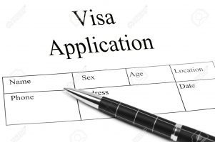 10063081-Visa-Application-and-an-pen-Stock-Photo